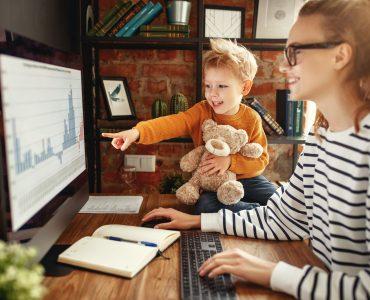 Boy asking mother about data analysis during work